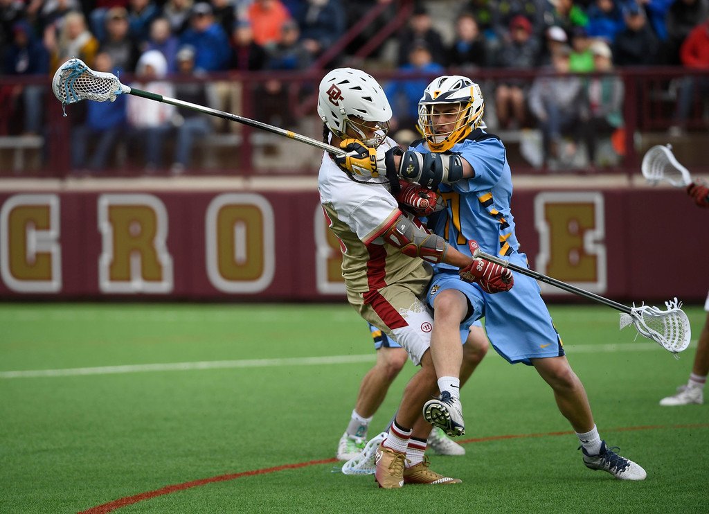 . Denver Pioneers midfielder Zach Miller #33 gets harassed while shooting against Marquette Golden Eagles defenseman Tyler Gilligan #17 in the fourth quarter during the Big East Championship game at Peter Barton Stadium May 07, 2016. DU out 10-9. (Photo by Andy Cross/The Denver Post)