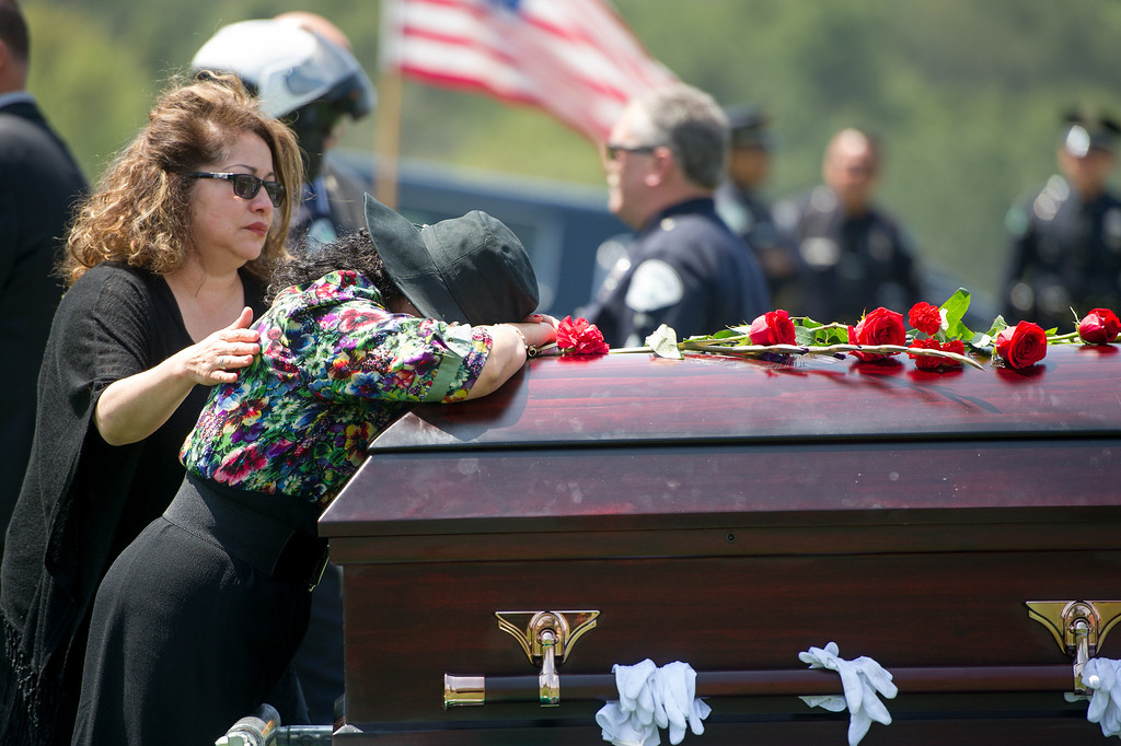 . Lillie Price grieves at the casket of LAPD officer Chris Cortijo, Tuesday, April 22, 2014, at Forest Lawn Hollywood Hills. (Photo by Michael Owen Baker/L.A. Daily News)