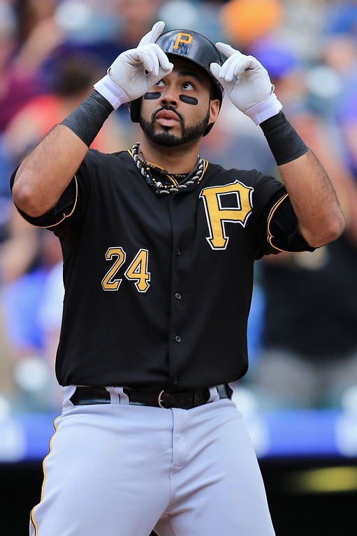 . Pedro Alvarez #24 of the Pittsburgh Pirates celebrates his solo home run off of starting pitcher Chad Bettis #35 of the Colorado Rockies to give the Pirates a 1-0 lead in the second inning at Coors Field on August 11, 2013 in Denver, Colorado.  (Photo by Doug Pensinger/Getty Images)