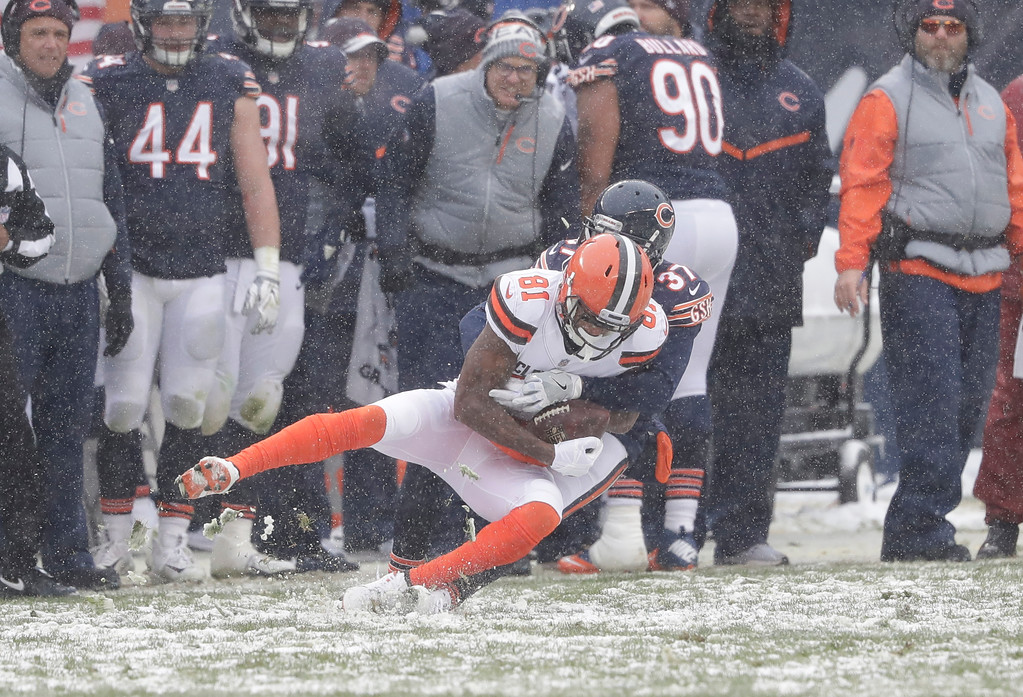 . Cleveland Browns wide receiver Rashard Higgins (81) pulls in a pass as Chicago Bears cornerback Bryce Callahan (37) defends in the first half of an NFL football game in Chicago, Sunday, Dec. 24, 2017. (AP Photo/Charles Rex Arbogast)