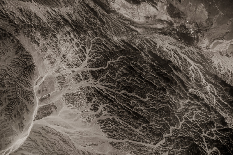 Black and white view from plane. Rivers winding through valleys in the mountains of South West Pakistan. (Post work to increase contrast and clarity to compensate for atmospheric haze).