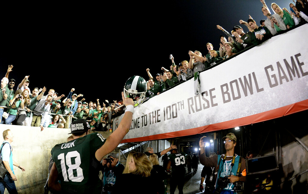 . Michigan State\'s Connor Cook (18) celebrates after defeating Stanford 24-20 during the 100th Rose bowl game in Pasadena, Calif., on Wednesday, Jan.1, 2014.   (Keith Birmingham Pasadena Star-News)