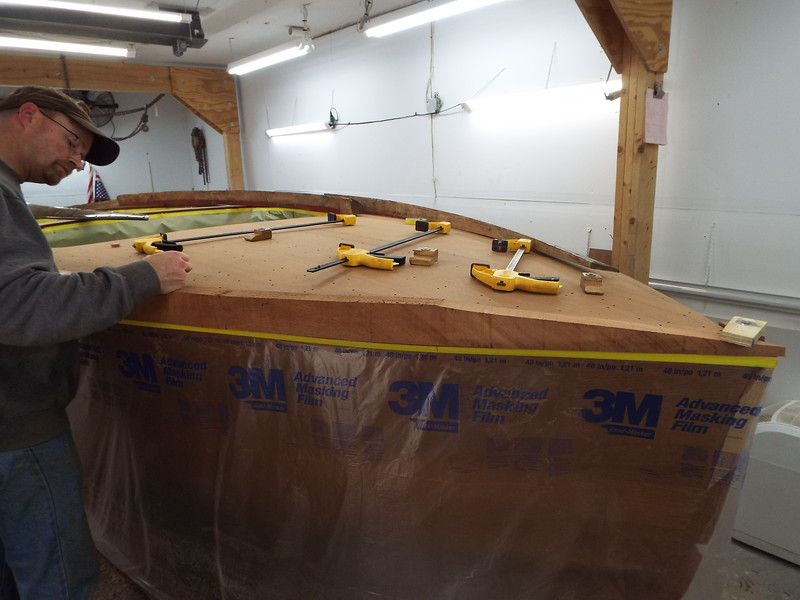 Another view of the front starboard cover board being fit.