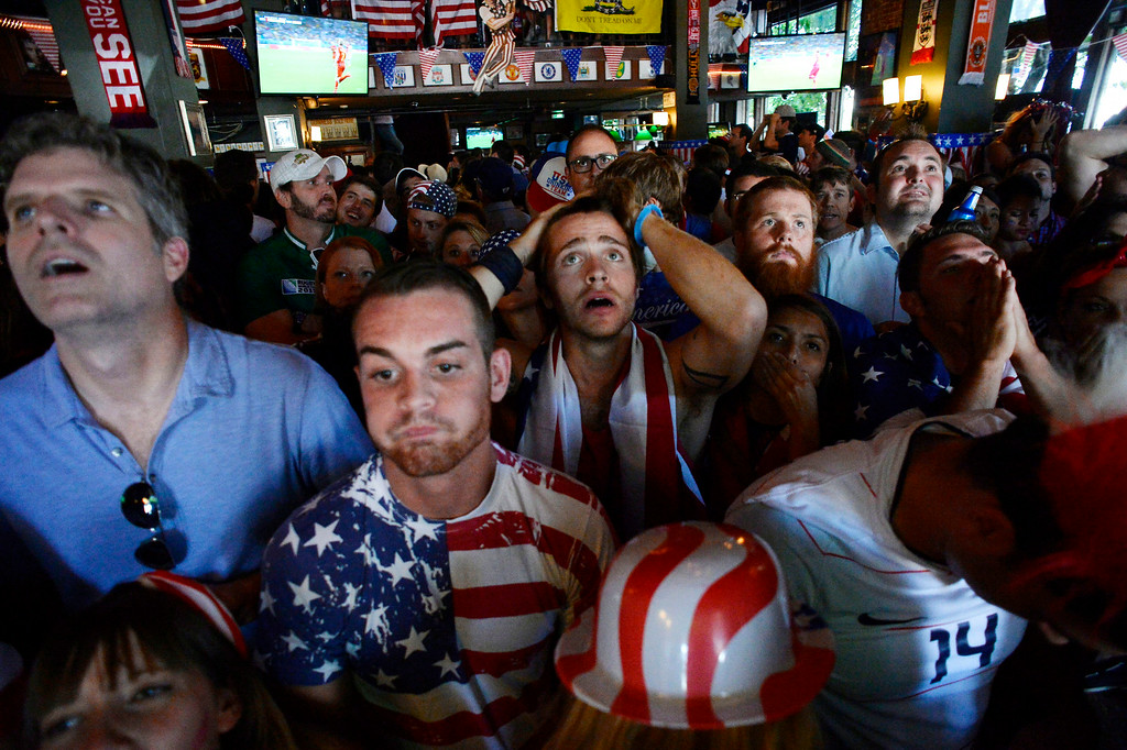 . Fans react after Belgium\'s first goal in extra time against he USA as they watch at The Three Lions July 1, 2014 to watch the United States take on Belgium in the World Cup. (Photo by John Leyba/The Denver Post)