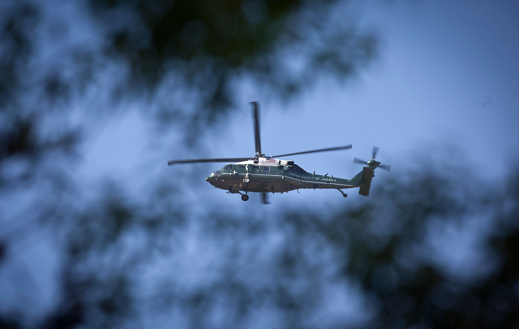 . A U.S. helicopter flies in the sky over Pretoria, not far from the Mediclinic Heart Hospital where former South African President Nelson Mandela is being treated, in South Africa Tuesday, June 25, 2013. South African President Jacob Zuma told dozens of foreign and South African journalists on Monday that President Barack Obama would go ahead with a visit to South Africa, despite concerns about Mandela\'s health. (AP Photo/Ben Curtis)