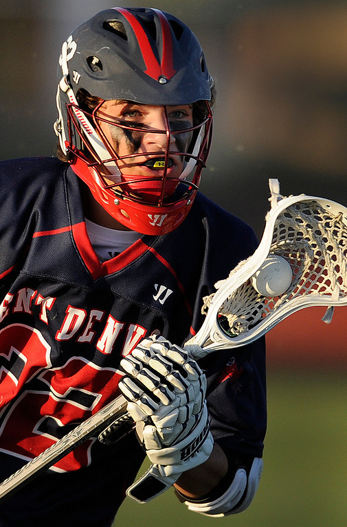 . AURORA, CO. - APRIL 24:  Kent Denver junior middie controlled the ball in the first half. The Regis Jesuit High School boy\'s lacrosse team defeated Kent Denver 10-8 Wednesday night, April 24, 2013. Photo By Karl Gehring/The Denver Post