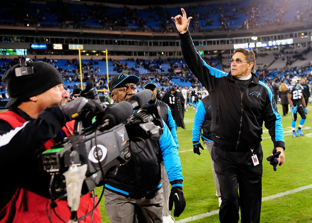 . Coach Ron Rivera of the Carolina Panthers salues the fans as he leaves the field after a win over New York Jets at Bank of America Stadium on December 15, 2013 in Charlotte, North Carolina. The Panthers won 30-20.  (Photo by Grant Halverson/Getty Images)