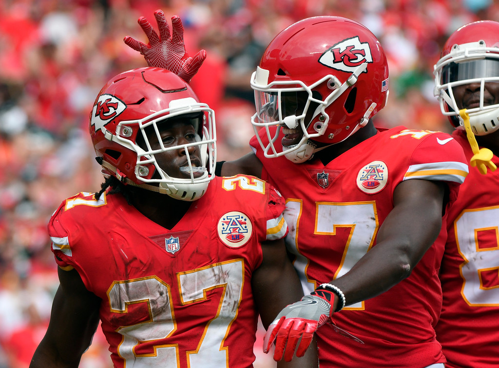 . Kansas City Chiefs running back Kareem Hunt (27) is congratulated by wide receiver Chris Conley (17) after scoring a touchdown against the Philadelphia Eagles during the second half of an NFL football game in Kansas City, Mo., Sunday, Sept. 17, 2017. (AP Photo/Ed Zurga)