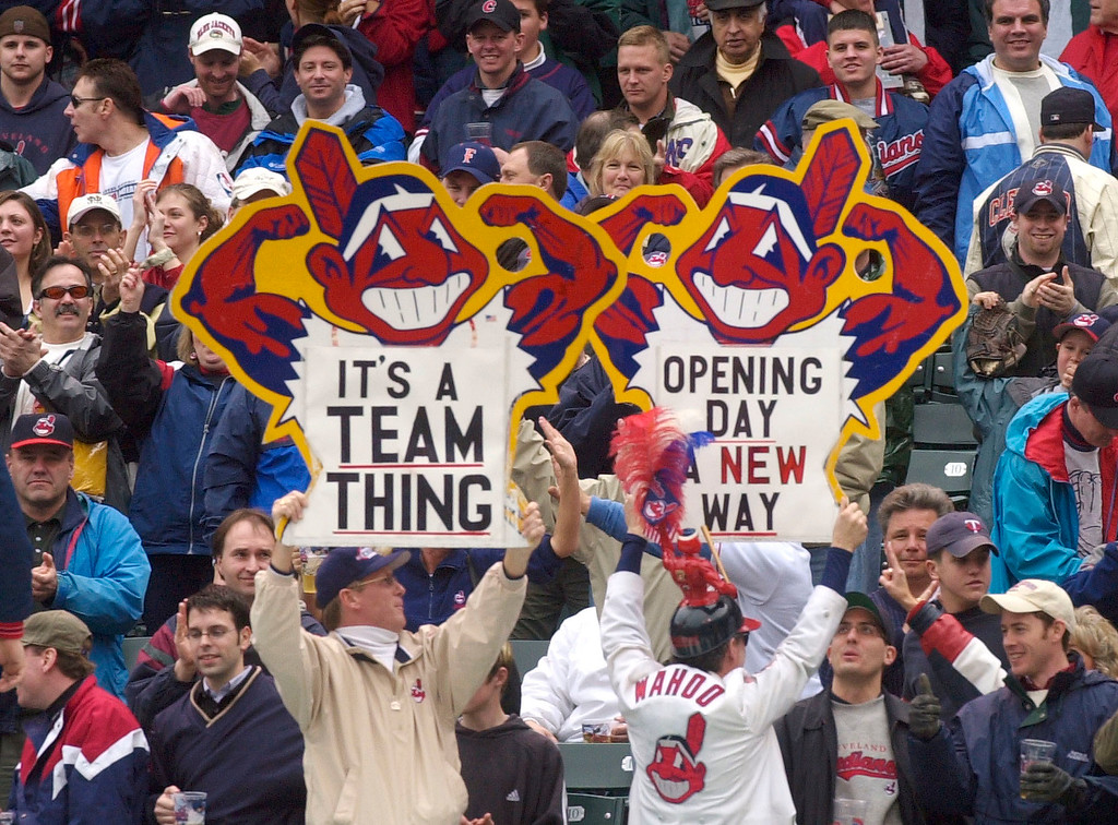 . Fans hold up Chief Wahoo signs as they celebrate the Cleveland Indians\' win over the Minnesota Twins, in Cleveland, Ohio.  (AP Photo/Tony Dejak, File)