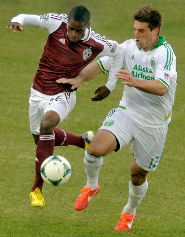 . Deshorn Brown (26) of the Colorado Rapids battled for the ball with David Horst (12) of the Portland Timbers in the second half. The Colorado Rapids tied the Portland Timbers 2-2 Saturday, March 30, 2013 at Dick\'s Sporting Goods Park in Commerce City.  Photo By Karl Gehring/The Denver Post)
