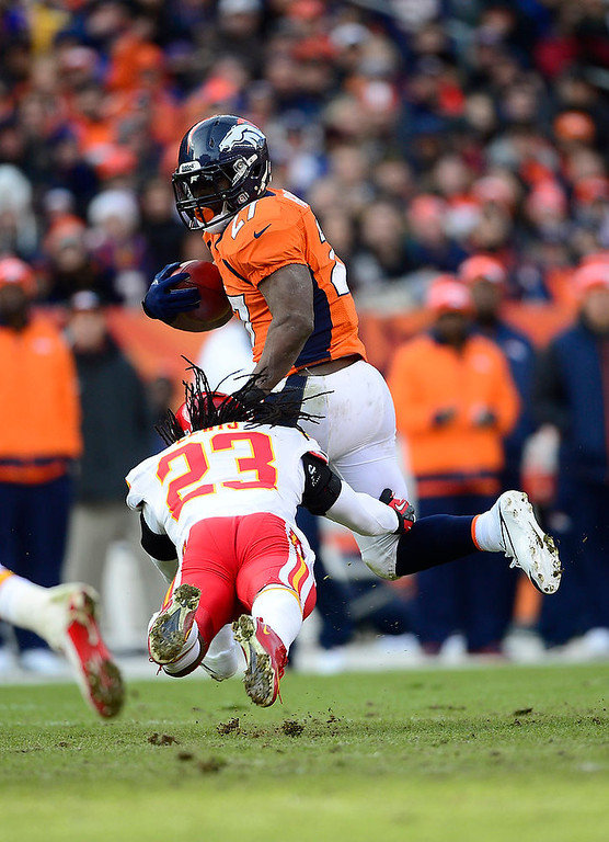 . Denver Broncos running back Knowshon Moreno (27) is tackled by Kansas City Chiefs free safety Kendrick Lewis (23) as the Denver Broncos took on the Kansas City Chiefs at Sports Authority Field at Mile High in Denver, Colorado on December 30, 2012. AAron Ontiveroz, The Denver Post
