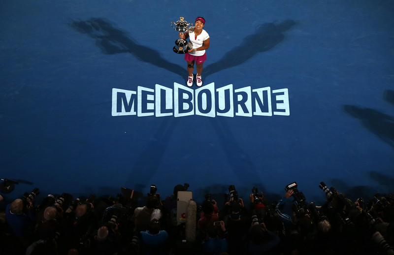 . Li Na of China holds the championship trophy after defeating Dominika Cibulkova of Slovakia in their women\'s singles final at the Australian Open tennis championship in Melbourne, Australia, Saturday, Jan. 25, 2014.(AP Photo/Eugene Hoshiko)