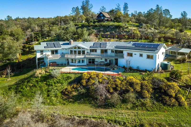 Drone-image-of-large-house-on-hillside.jpg
