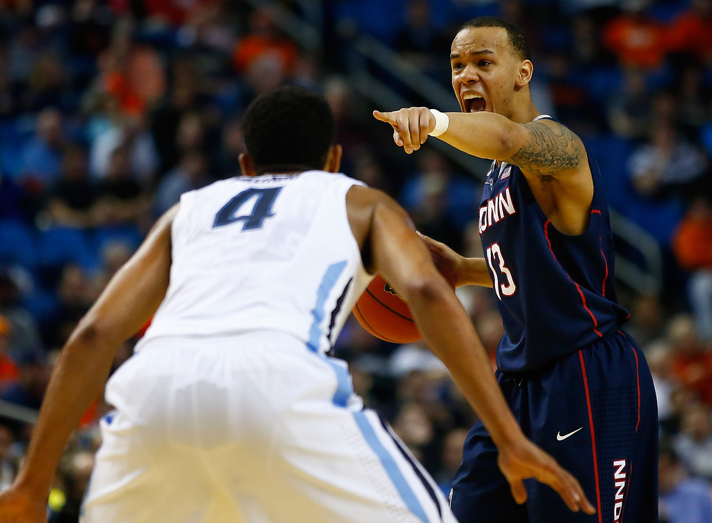 . BUFFALO, NY - MARCH 22: Shabazz Napier #13 of the Connecticut Huskies calls a play against the Villanova Wildcats during the third round of the 2014 NCAA Men\'s Basketball Tournament at the First Niagara Center on March 22, 2014 in Buffalo, New York.  (Photo by Jared Wickerham/Getty Images)