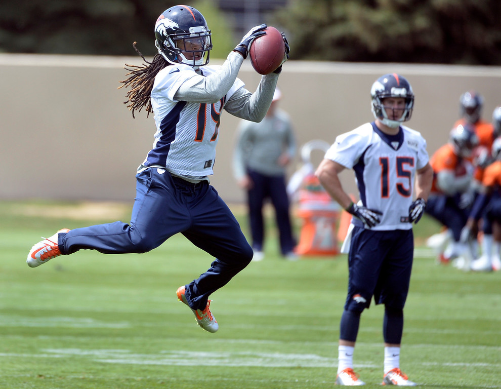 . Isaiah Burse (19) runs through drills with fellow rookies as the Denver Broncos host their rookie minicamp at Dove Valley in Englewood on Friday, May 16, 2014.  (Kathryn Scott Osler, The Denver Post)