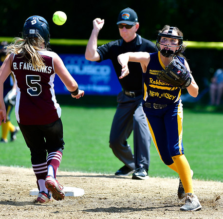 7/24/2019 Mike Orazzi | Staff New Jersey's Haley Krebs (17) forces out Rhode Island's Brooke Fairbanks (5) during Wednesday's Little League Softball game in Bristol.