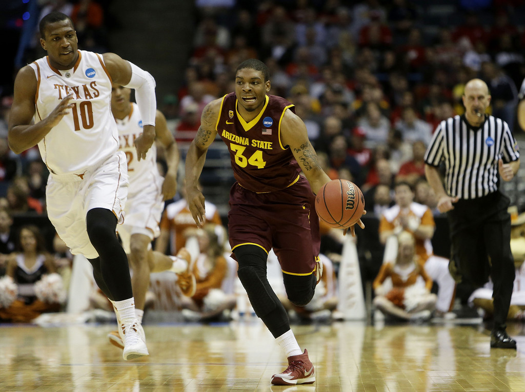 . Jermaine Marshall #34 of the Arizona State Sun Devils controls the ball against Jonathan Holmes #10 of the Texas Longhorns in the second half during the second round of the 2014 NCAA Men\'s Basketball Tournament at BMO Harris Bradley Center on March 20, 2014 in Milwaukee, Wisconsin.  (Photo by Mike McGinnis/Getty Images)