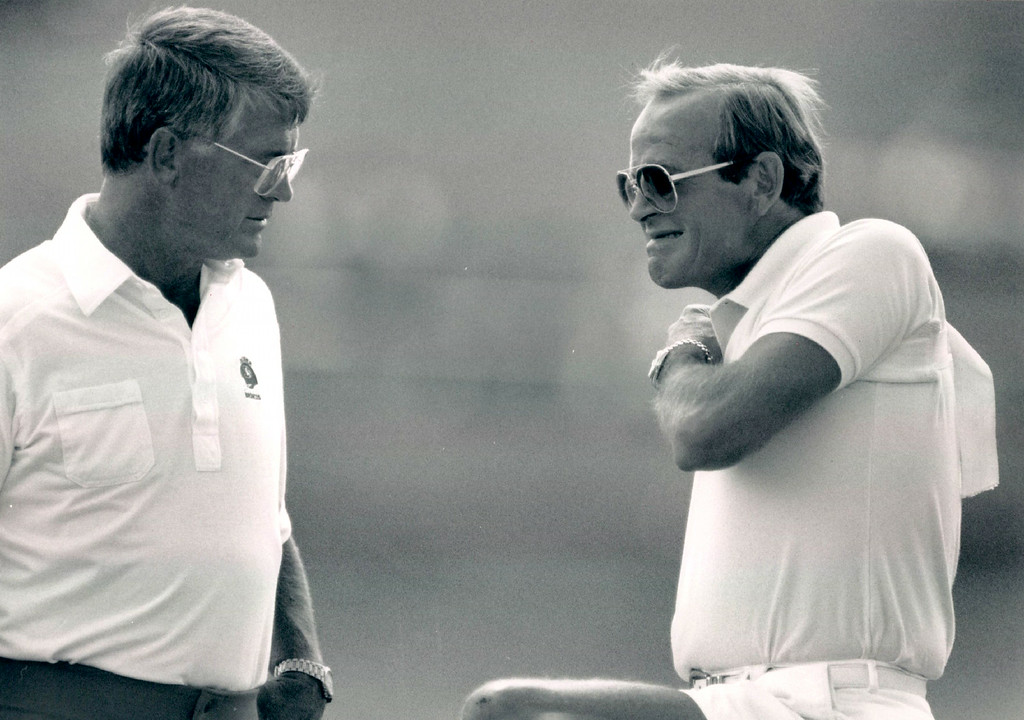 . Dan Reeves right and Pat Bowlen, Broncos owner, adjusts his brace he was wearing after a bicycle accident. Bowlen Showed up at Broncos and had a chat with Coach Reeves. 1989. Credit: The Denver Post