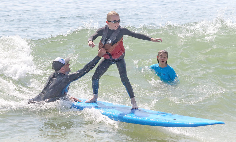 [L-R]: James Enze, from lavallette, Ethan Buge, from Dallas TX, and Malia Enze, from Lavallette.Waves of Impact day 1 in Lavallette, NJ on 8/1/19.[DANIELLA HEMINGHAUS]