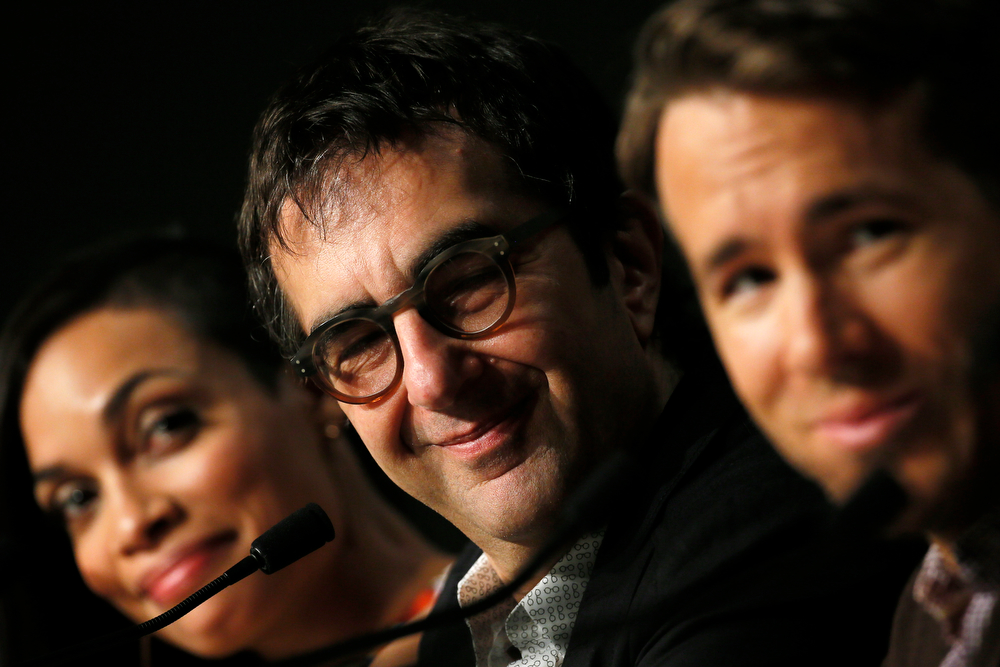 . Director Atom Egoyan smiles during a press conference for Captives at the 67th international film festival, Cannes, southern France, Friday, May 16, 2014. (AP Photo/Alastair Grant)