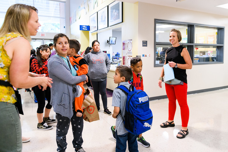 Hallman principal Jessica Brenden, right, greets students and their families. Back to school day at Hallman Elementary School on Wednesday, September 4, 2019 in Salem, Ore.
