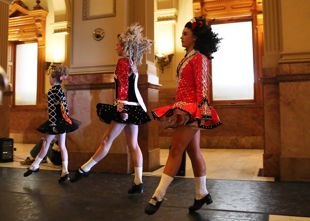 . Students from the Wick School of Irish Dance perform in celebration of St. Patrick\'s Day, inside the state Capitol, in Denver, Monday March 17, 2014. (AP Photo/Brennan Linsley)