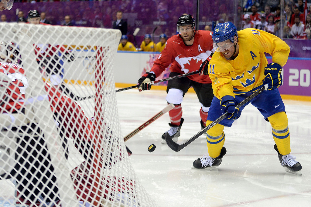 . Daniel Alfredsson (11) of Sweden takes a shot on Carey Price (31) of Canada during the second period of the men\'s ice hockey gold medal game. Sochi 2014 Winter Olympics on Sunday, February 23, 2014 at Bolshoy Ice Arena. (Photo by AAron Ontiveroz/ The Denver Post)