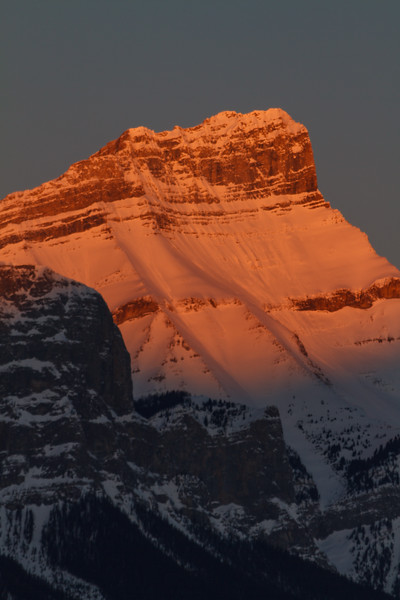 Sunset colors on snowy peek in Canada