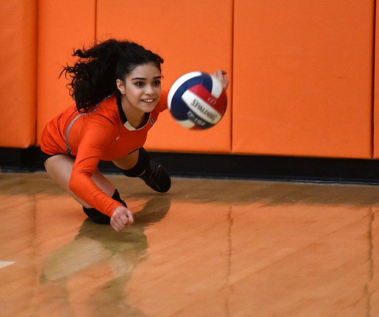 10/18/2019 Mike Orazzi | StaffrGoodwin Tech's Nathalie DeLarosa (3) during Friday night's girls volleyball match with Terryville in Terryville.