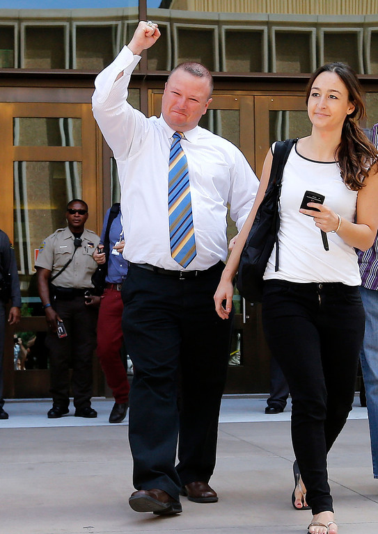 . David Hall, a friend of Travis Alexander, pumps his fist outside Superior Court  in Phoenix, Wednesday, May 8, 2013 to a guilty verdict in the trial of Jodi Arias. Arias was a waitress and aspiring photographer charged with killing her boyfriend, Travis Alexander, in Arizona in 2008. The four month trial included graphic details of their sexual escapades and photos of Alexander just after his death. (AP Photo/Matt York)