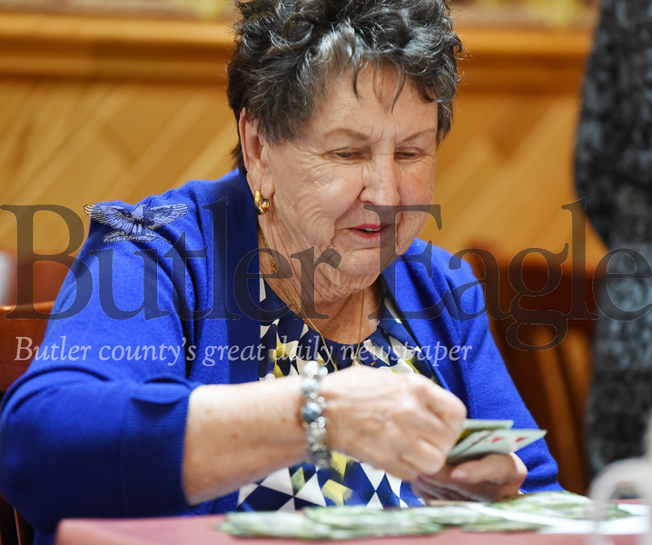 Harold Aughton/Butler Eagle: Dolly Bertuzzi of Butler deals out a hand during a recent card club meeting at Mama Rosa's.