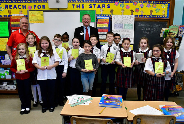 12/11/2018 Mike Orazzi | Staff Rotary Club of New Britain-Berlin's Mark Bernacki after handing out dictionaries to 3 grade students in Mr. Gary Kus' class at the Holy Cross School in New Britain Tuesday morning. Each year the rotary provides all city 3 grade students with dictionaries.