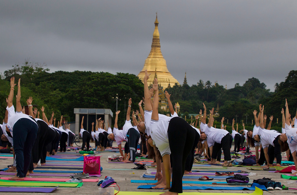 . People practice yoga on International Yoga Day, in front of Shwedagon pagoda in Yangon, Myanmar Wednesday, June 21, 2017. Yoga enthusiasts took part in mass yoga programs to mark International Yoga Day throughout the world.  (AP Photo/Thein Zaw)