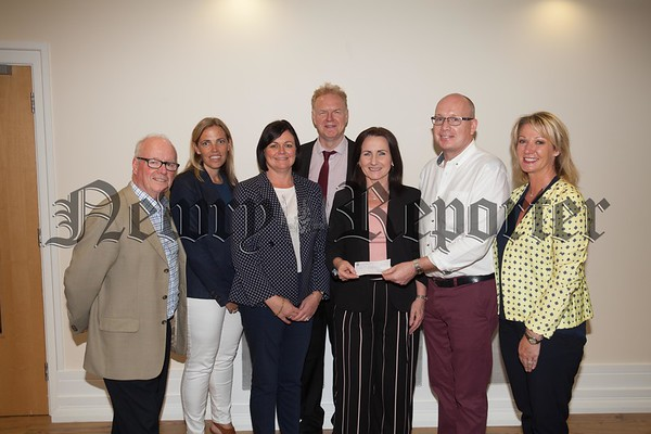 Members of Clanrye Abbey Development Michael Savage, Ciara Blaney, Jane Magill, Peter McEvoy and Brendan Jackson present a cheque to Nicky Kinsella nd Karen McNally from Newry Rugby Club for £10000. R1726012