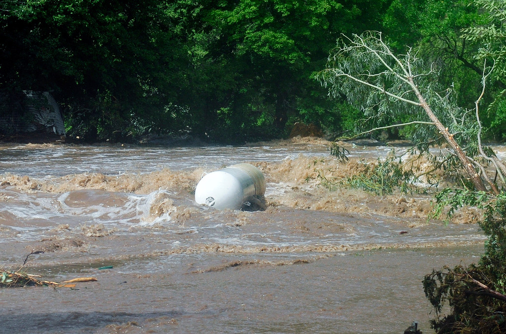 . A propane tank floats down the North St. Vrain River in Lyons Friday, Sept. 13, 2013. (Greg Lindstrom/Times-Call)