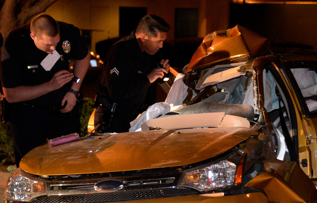 . LA City firefighters at the scene of a high speed crash in the16700 block of Roscoe Blvd., east of Balboa Blvd.  The driver lost control and hit a light poll on the passenger side, killing the passenger. The driver was taken away in serious condition. Van Nuys CA. Dec 30,2013. Photo by Gene Blevins/LA DailyNews