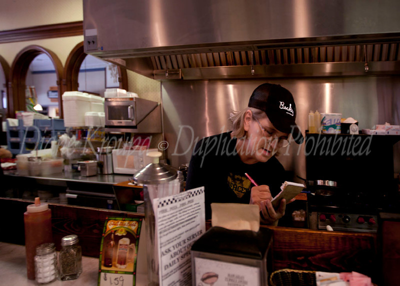 "Our very special ""Star"" waitress who was exceptionally helpful taking our order at the soda fountain area in Leavenworth, Kansas.   This pharmacy has been at this location for over 130 years.  The present pharmacist and owner, Ron Booth bought the pharmacy in 1980 and restored the store with meticulous attention to detail and authenticity.  The food is as good as it gets and visiting this nostalgic store was a trip down memory lane for me.  I  hope to return again soon and try their signature, old time flavor hamburgers or hot dogs.  Photo #110"
