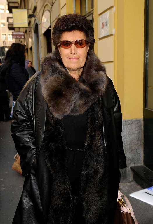 . FILE - In this Thursday, Feb. 24, 2011 file photo Carla Fendi arrives at her company fashion show in Milan, Italy. Carla Fendi, one of the five sisters who transformed the family leather goods business into a global luxury fashion house long known for its furs, has died following a long illness.  The Rome-based fashion house confirmed Fendi�s death Monday, June 19, 2017, at the age of 79, expressing pain for the loss and gratitude for her continued contributions. (AP Photo/Giuseppe Aresu, file)