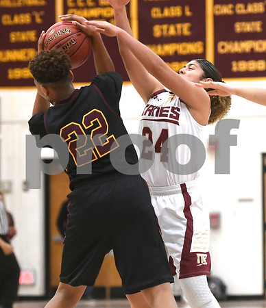1/13/2018 Mike Orazzi | Staff New Britain's Savannah Gonzalez (24) and Medgar Evers College Preparatory School's Taylir Manhertz (22) in New Britain Saturday afternoon.