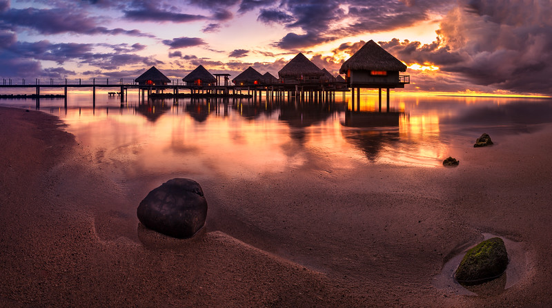 Tahiti bungalows with sunset near beach