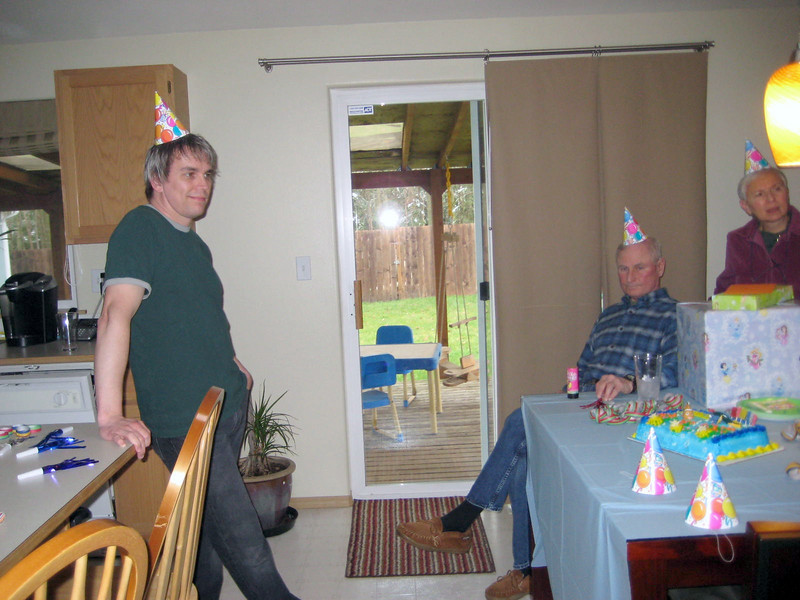 Waiting to surprise Kimber...with our party hats on.