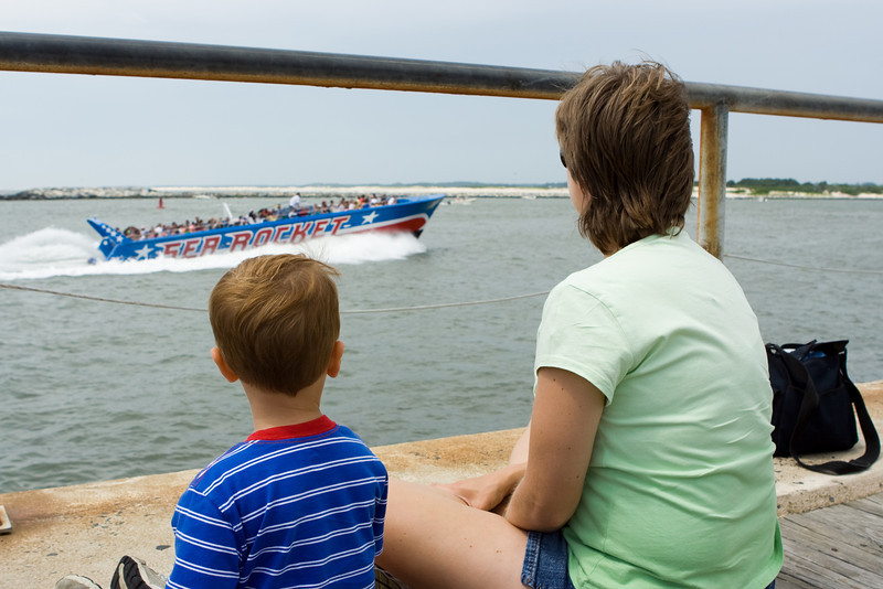 Mom looks on as K.C. admires one of the many tourist boats.