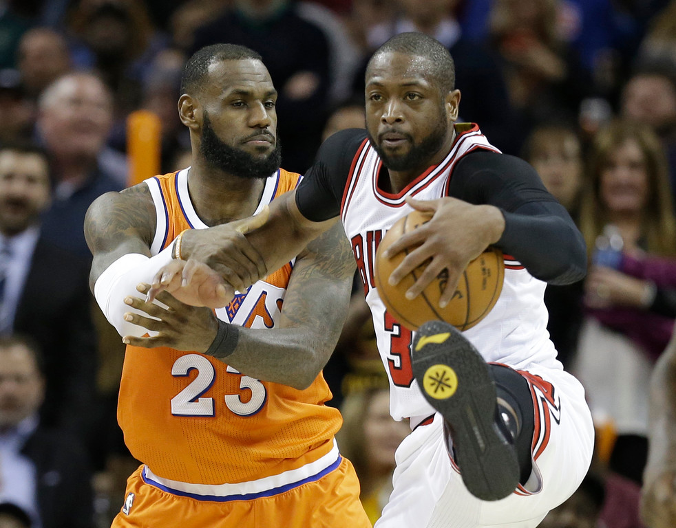 . Cleveland Cavaliers\' LeBron James, left, fouls Chicago Bulls\' Dwyane Wade in the second half of an NBA basketball game, Wednesday, Jan. 4, 2017, in Cleveland. The Bulls won 106-94. (AP Photo/Tony Dejak)