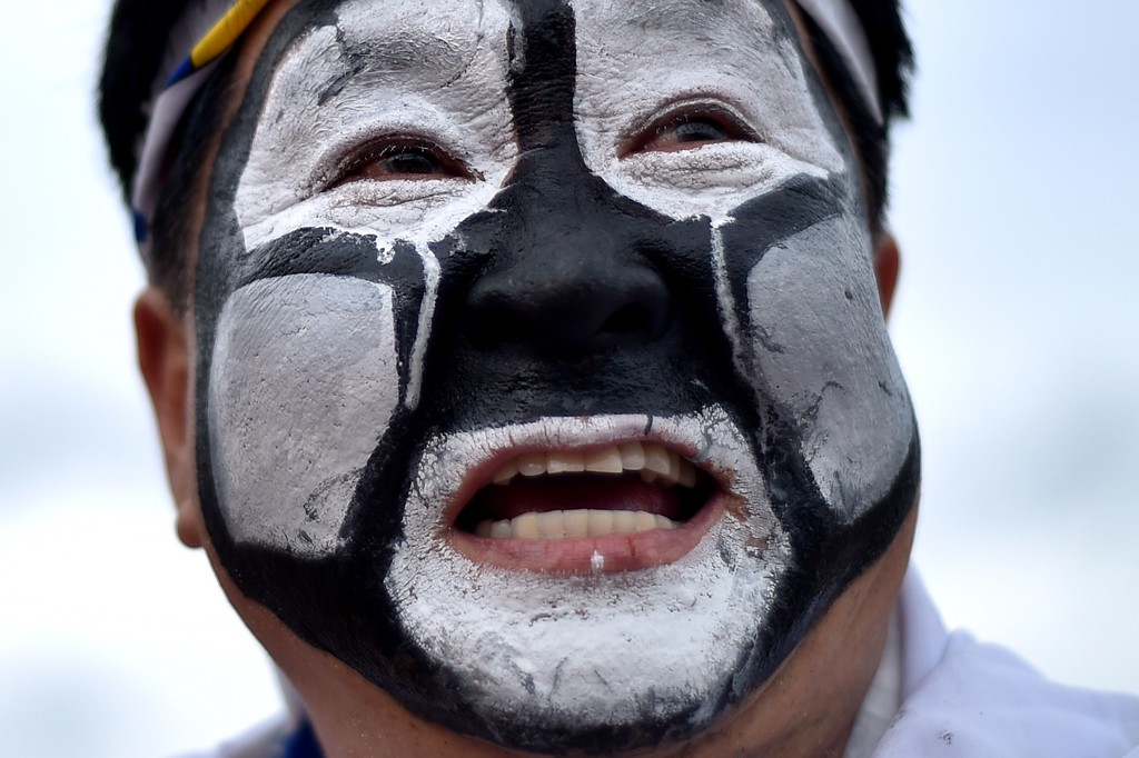 . A South Korean fan reacts outside the Pantanal Arena prior to a 2014 FIFA World Cup Group H football match between Russia and South Korea in Cuiaba on June 17, 2014.    AFP PHOTO/ KIRILL KUDRYAVTSEV/AFP/Getty Images