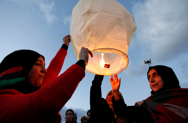 . Libyans release a lantern in the air at Nasr Square, during the second anniversary of the uprising that toppled longtime dictator Moammar Gadhafi in Benghazi, Libya, Sunday, Feb, 17, 2013.  (AP Photo/Mohammad Hannon)