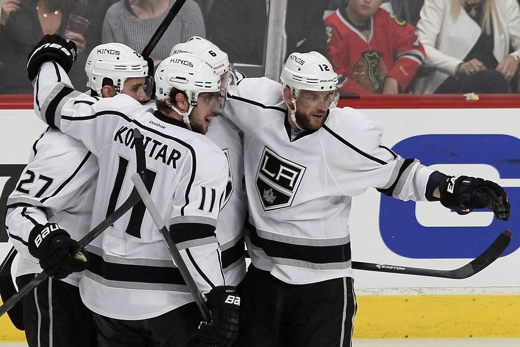 . Marian Gaborik #12 of the Los Angeles Kings celebrates with his teammates after scoring a goal against Corey Crawford #50 of the Chicago Blackhawks in the first period during Game Five of the Western Conference Final in the 2014 Stanley Cup Playoffs at United Center on May 28, 2014 in Chicago, Illinois.  (Photo by Tasos Katopodis/Getty Images)