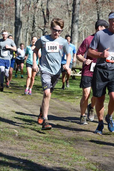 Liam Tuohy of South Salem runs past Kimberly Bridge (photo by Patty McMahon)