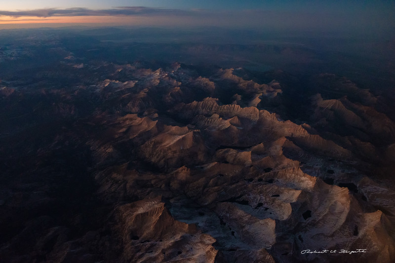 Sierra Nevada in twilight. Mono Lake at top of the picture.