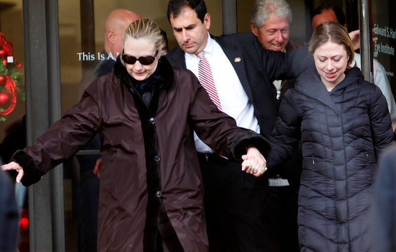 . U.S. Secretary of State Hillary Clinton leaves New York Presbyterian Hospital  with husband, Bill (TOP), and daughter, Chelsea (R), in New York, January 2, 2013. The secretary of state, who has not been seen in public since Dec. 7, was revealed on Sunday evening to be in a New York hospital under treatment for a blood clot that stemmed from a concussion she suffered in mid-December. REUTERS/Joshua Lott