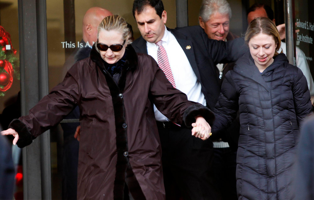 Description of . U.S. Secretary of State Hillary Clinton leaves New York Presbyterian Hospital  with husband, Bill (TOP), and daughter, Chelsea (R), in New York, January 2, 2013. The secretary of state, who has not been seen in public since Dec. 7, was revealed on Sunday evening to be in a New York hospital under treatment for a blood clot that stemmed from a concussion she suffered in mid-December. REUTERS/Joshua Lott